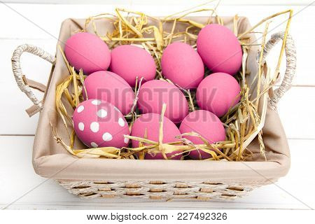 Pink Easter Eggs On Wodden Background. Still Life Photo Of Lots Of Pink Easter Eggs. Copyspace