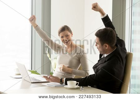 Excited Businesswoman And Businessman Yelling And Emotionally Celebrating Great Achievement In Caree