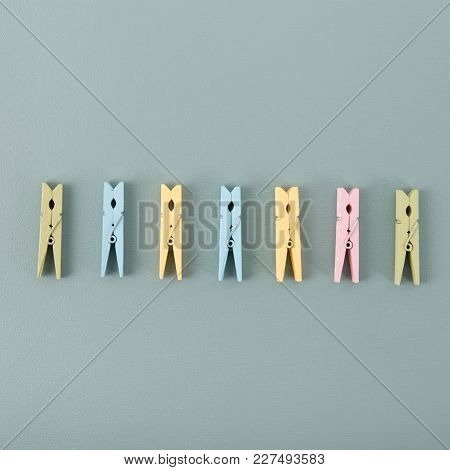 Top View Of Wooden Colored Clothespins Composed In One Row.