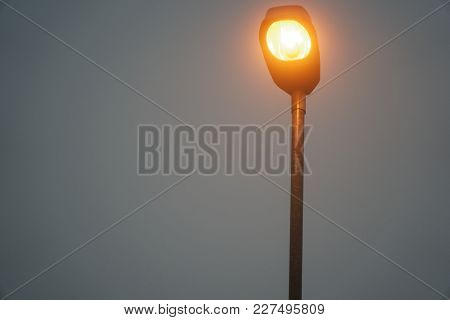 Street Lights In Foggy Weather, Late Autumn, Mistic Haze Or Mist.