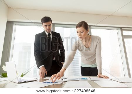 Female And Male Coworkers Of It Company Design Department Discussing Color Scheme Of Developed Appli