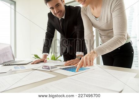 Woman Pointing On Variation Of Blue Color On Pantone Swatch When Choosing Paint Tone For Apartment W