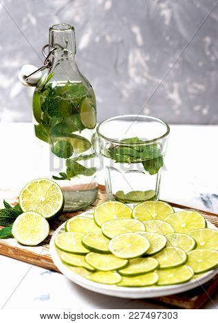 Cold fresh lemonade drink with mint and green lime