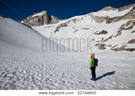 An alpinist looking at the summit