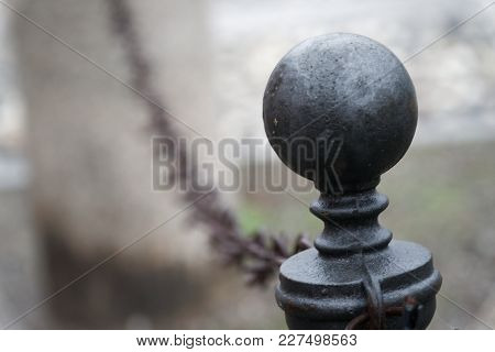 Metal Fence Decorated With Round Ball Gray Steel Ball And Chain On Background.