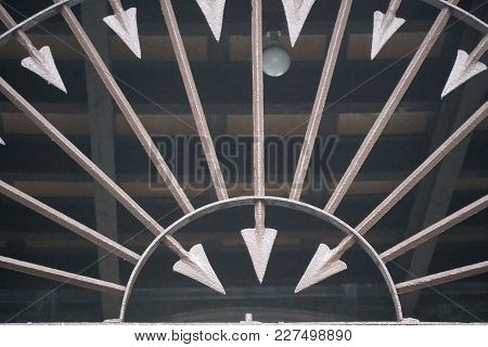 Metal Fence Decorated With Sharp Arrows Into Round Form, Brown Steel Arrow.