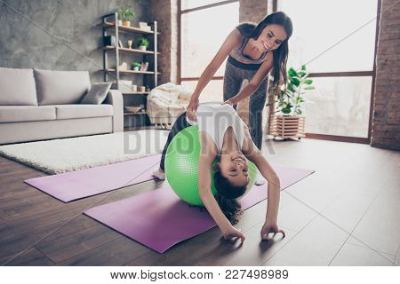 People Ans Sport Concept. Charming Small Cute Funny Joyful Active Sportive Girl Is Lying Upside-down
