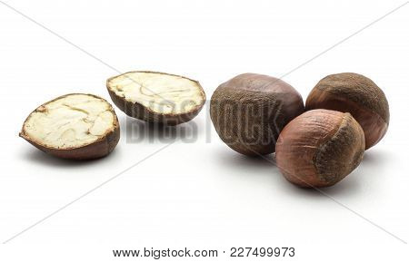 European Chestnuts One Cut In Two Halves Isolated On White Background Spanish Edible Raw Fresh Brown