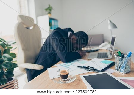 Very Tired Man With Black Skin Economist, Sleep On His Hands While Sitting At Desk During Break Time