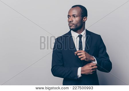 Portrait Of Stunning, Trendy, Attractive, Dreamy, Perfect Man In Black Suit With Tie Fasten Button O