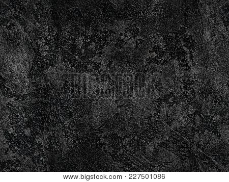 Natural Black Volcanic Seamless Stone Texture Venetian Plaster Background. Dark Volcanic Rock Veneti