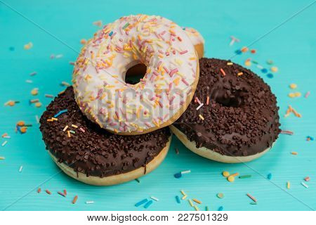 Three Donuts, One On Top Of Another, Chocolate And White Cream. Cropped Image