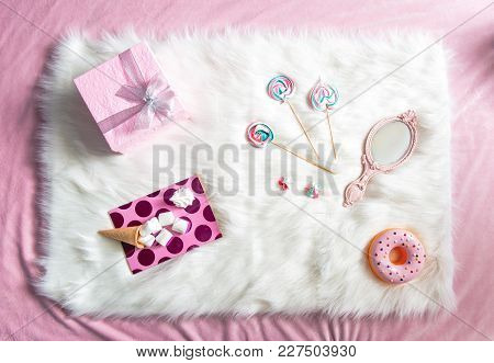 Top View Rosy Present, Sweets, Marshmallow, Copybook And Mirror Situating On Floor. Fashion Concept