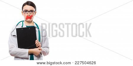 Portrait Of Young Attractive Female Doctor In White Coat Standing In Office Looking In Camera And Ho