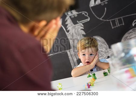 Cute Little Playfull Toddler Boy At Child Therapy Session. Private One On One Homeschooling With Did