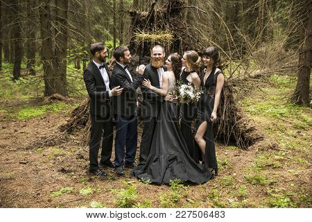 Portrait Of The Couple And Witnesses In A Forest