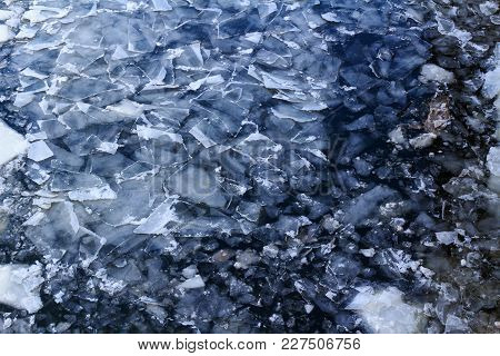 Broken Ice On The Surface Of The River In Winter. Ice Floes Texture