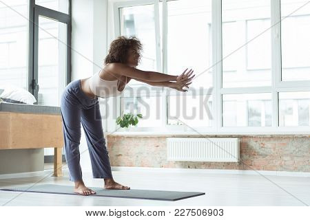 Full Length Side View Happy African Girl Engaging In Sports Activities At Home. Health Concept. Copy