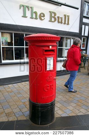 Bracknell, England - February 19, 2018: A Pedestrian Passes By A Traditional Red, King George Post B