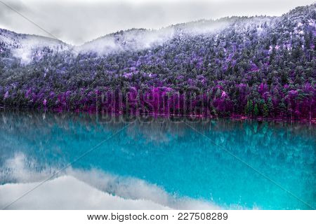 Beautiful Lake  In German And Austrian Alps With Big Snowy Mountains On Background In Winter. Misty