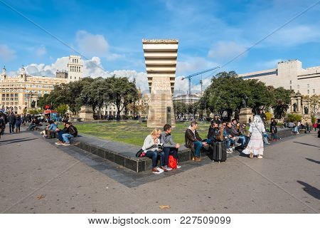 Barcelona, Spain - December 5, 2016: People Rest On The Square Of Catalonia (placa De Catalunya) In