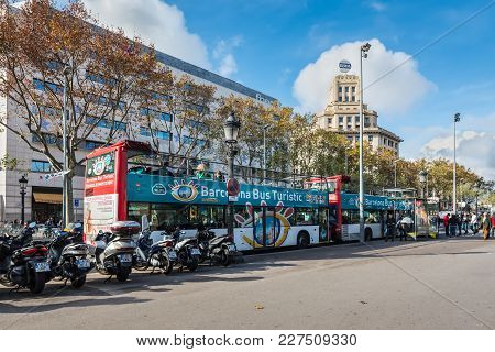 Barcelona, Spain - December 5, 2016: Tourist Buses On The Square Of Catalonia (placa De Catalunya) I