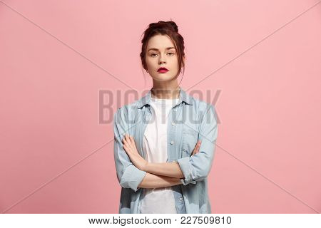 Serious Business Woman Standing, Looking At Camera Isolated On Trendy Pink Studio Background. Beauti