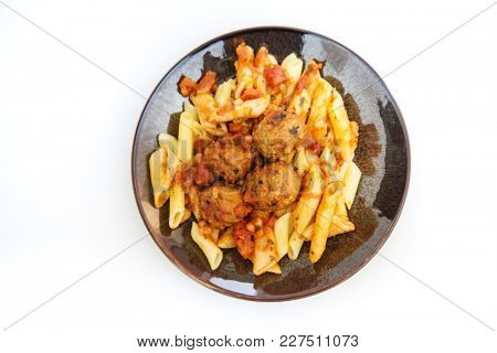Tasty penne with Meat balls and tomato sauce
