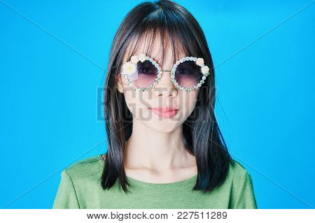 Women Wear Fashion Glasses Showing Happy Gestures, Blue Background.
