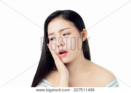 Asian Girl In White Casual Dress Show Off The Toothache, Maybe Because Of Not Maintaining Good Oral