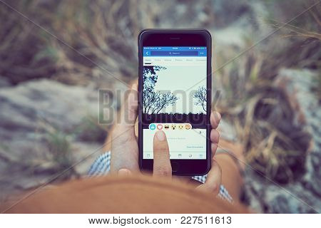 Bangkok, Thailand - February 20, 2018 : Women Hand Is Pressing The Facebook Screen On Apple Iphone6