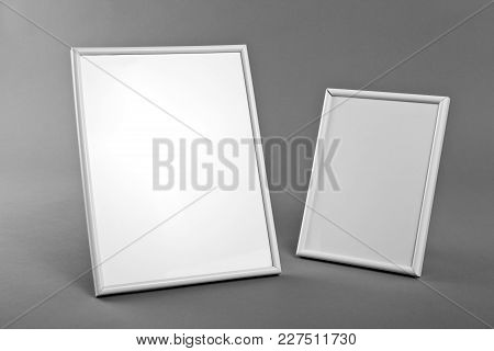 White Frames For Paintings Or Photographs On Gray Background