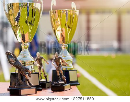 Soccer Football Tournament Trophies. Shining Golden Awards For The Best Team, Goalkeeper And Striker
