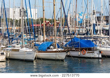 Barcelona, Spain - December 5, 2016: Sailboats Anchored In Port Vell, A Part Of The Waterfront Harbo