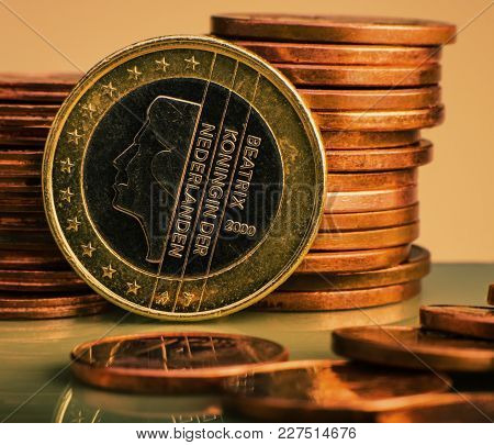 Coin One Euro. Coin On A Blurred Background Coin Denomination Of One Euro. Currency Of The European