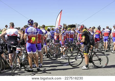 Mont-ventoux, France - September 1, 2016: On Arrival At The Summit Of Mount Ventoux Cyclists Are Hap