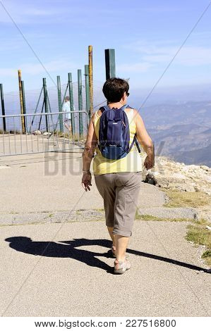 Mont-ventoux, France - September 1, 2016: Hiker With Backpack Reaching The Summit Of Mont Ventoux To