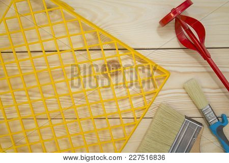 Repair, Redecorating Concept. A Yellow Plastic Grid, Paint Brushes And A Concrete Mixer On A Light U