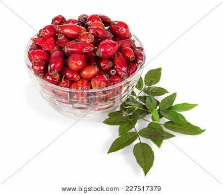Full Glass Bowl Fruits Of Rose Hips Isolated On White Background