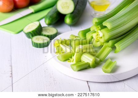 Cut Ripe Fresh Celery On White Cutting Board Healthy Diet Food Cucumber Vegetables