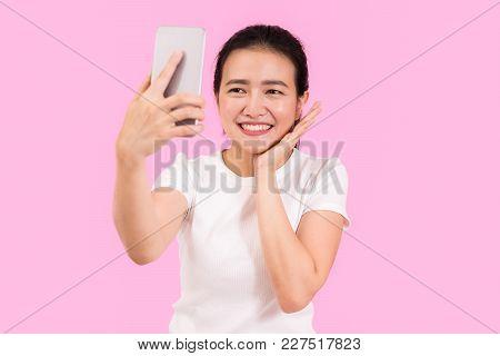 Cute Asian Woman Taking Selfie Shot With Smart Phone Camera, Beautiful Posting, Nice Smile, Social M