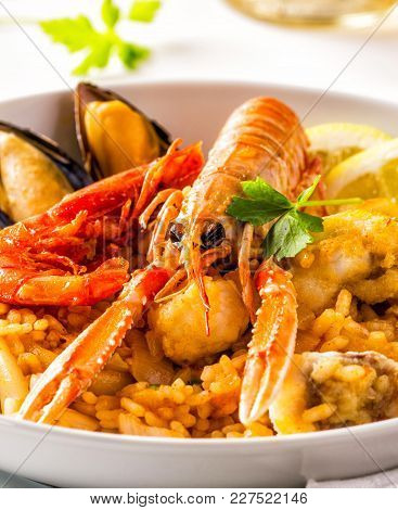 Closeup Of A Spanish Seafood Paella With Mussels And Shrimps.