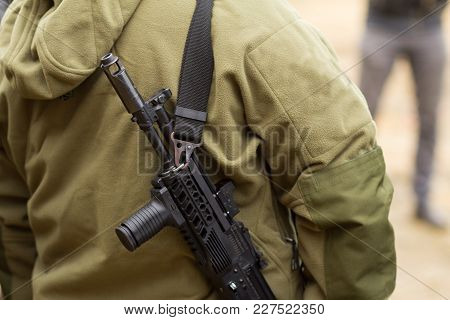 Soldier Or Hunter With Rifle On Shoulder