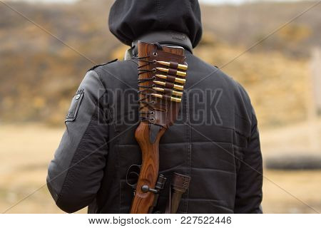 Close Up Pictre Of Hunter With Old Wooden Rifle With Bandolier Full Of Ammo