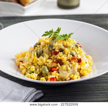 Vegetable Rice With Artichokes, Beans, Bell Pepper And Saffron.