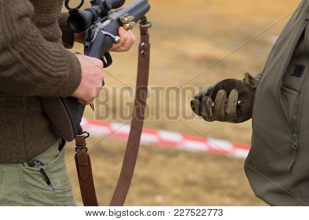Soldier Give Ammo To Sniper, Close Up Picture Of Rifle Reloading