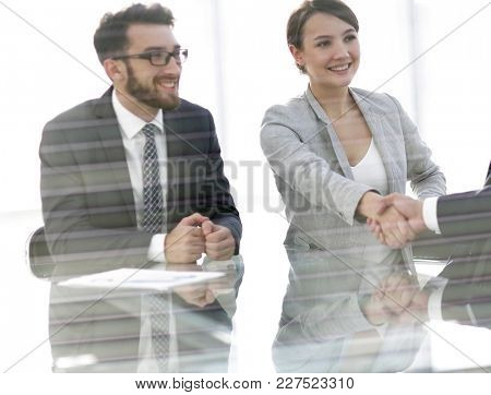 from behind the glass.handshake business people