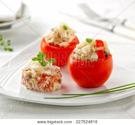 Delicious Appetizer: Stuffed Tomatoes On A Plate.