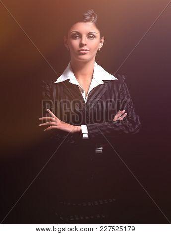 confident business women on black background.