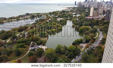View From Above Chicago Park Zoo, Diversey Harbor, North Pond And Lake Michigan With Chicago Downtow